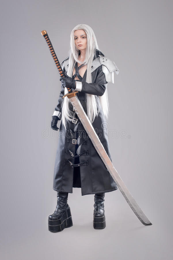 Fantasy woman warrior. Woman warrior with sword and armor isolated on the gray background stock image