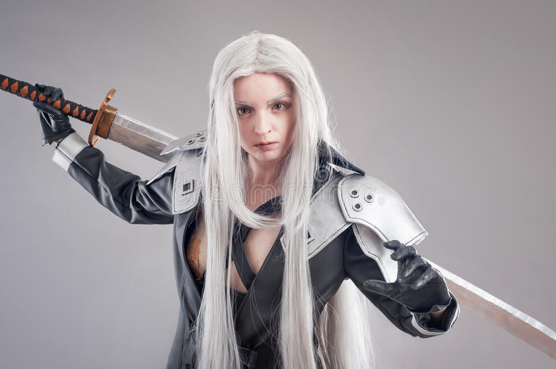Fantasy woman warrior. Woman warrior with sword and armor isolated on the gray background stock photos