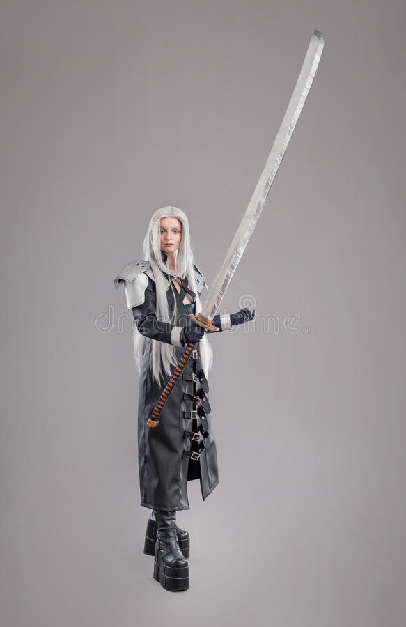 Fantasy woman warrior. Woman warrior with sword and armor isolated on the gray background royalty free stock photo
