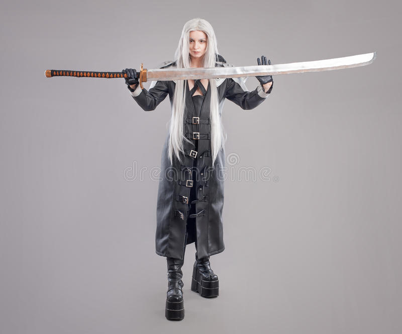 Fantasy woman warrior. Woman warrior with sword and armor isolated on the gray background stock photo