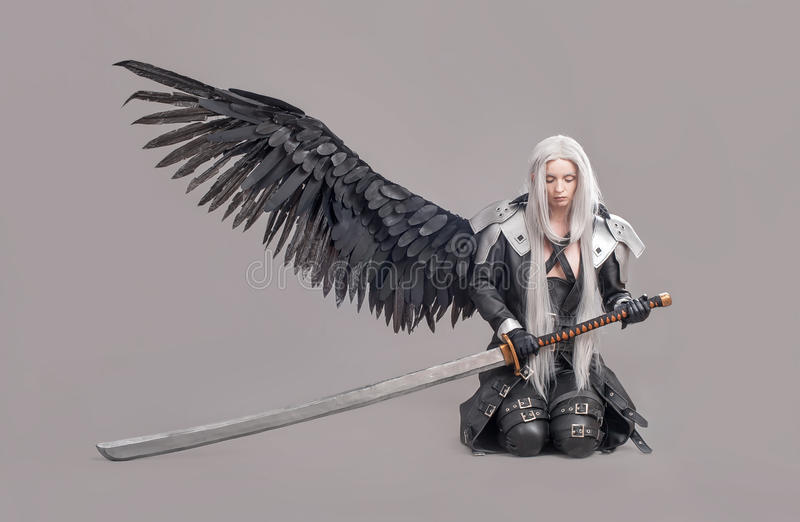 Fantasy woman warrior. Woman warrior with sword and wings isolated on the gray background royalty free stock photography