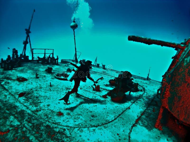 Fantasy Wreck Diver. Exploring the Deck of a Sunken Ship royalty free stock image