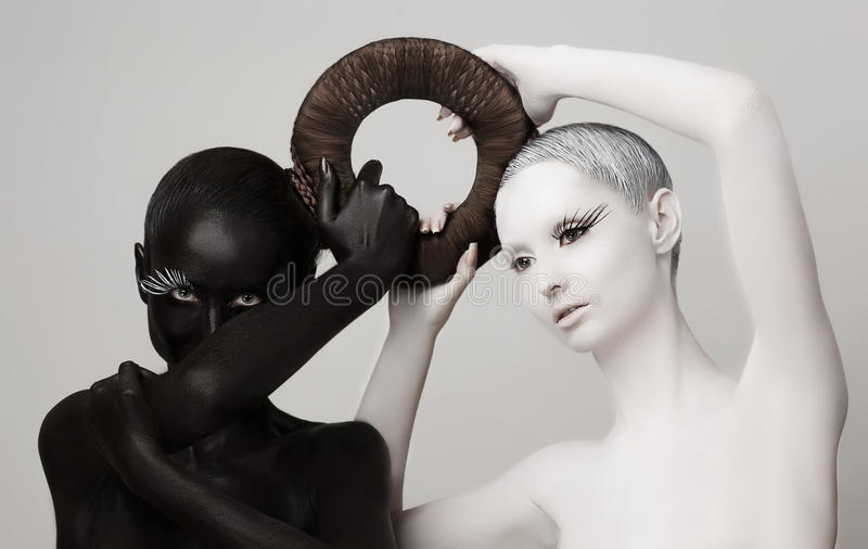 Fantasy. Yin & Yang Esoteric Symbol. Black & White Women Silhouettes. Yin & Yang East Symbol. Black & White Women Silhouettes. Contrasts royalty free stock photos