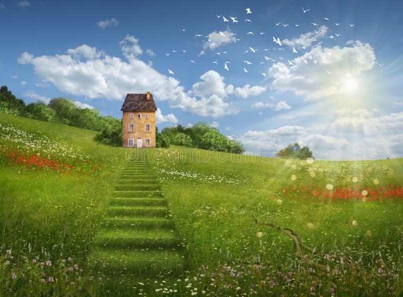 Fantazja dom w pięknym dniu i pole zdjęcie royalty free