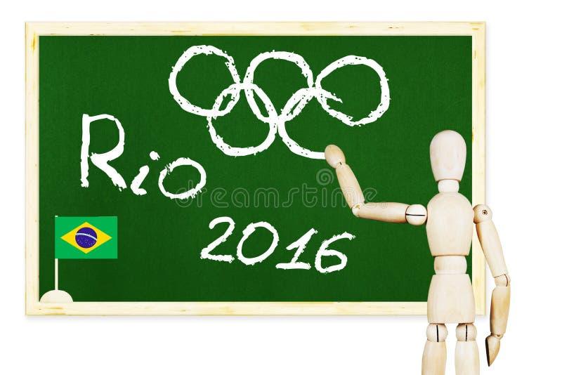Fantoche de madeira que tira símbolos olímpicos no quadro fotos de stock royalty free