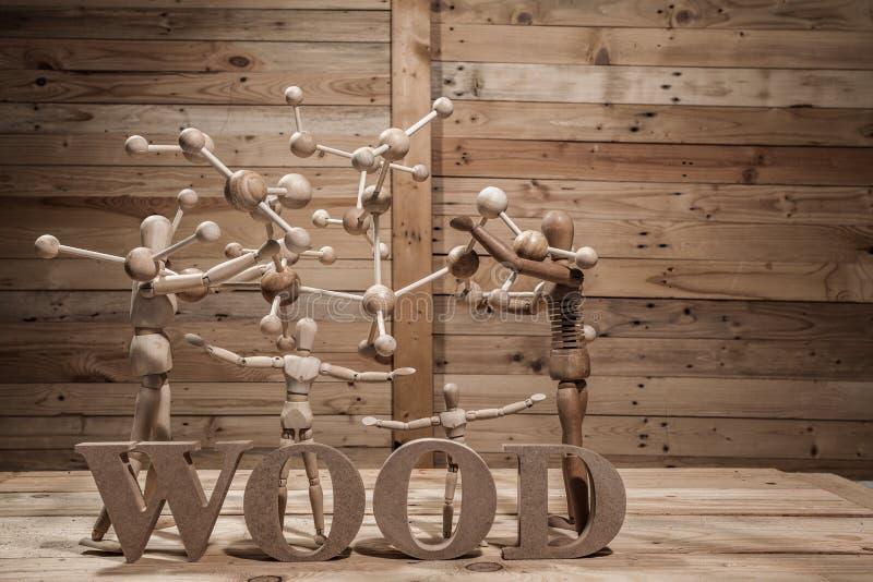 fantoches de madeira com palavra do átomo fotos de stock royalty free