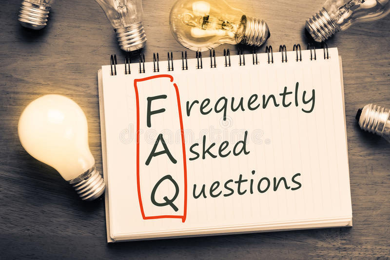 FAQ. ( frequently asked questions ) text on notebook with many light bulbs