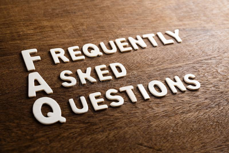 FAQs Wood Letters. FAQ Frequently Asked Questions text by wood letters on wood texture royalty free stock photos