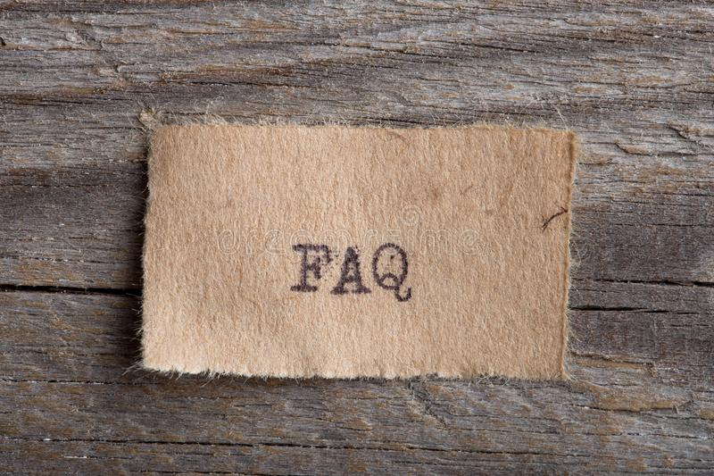 FAQ word on a piece of paper close up, business creative motivation concept. FAQ - word on a piece of paper close up, business creative motivation concept royalty free stock image