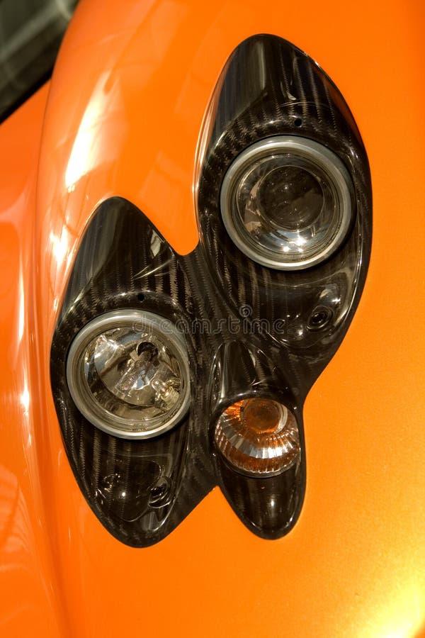Faróis supercar alaranjados fotografia de stock royalty free