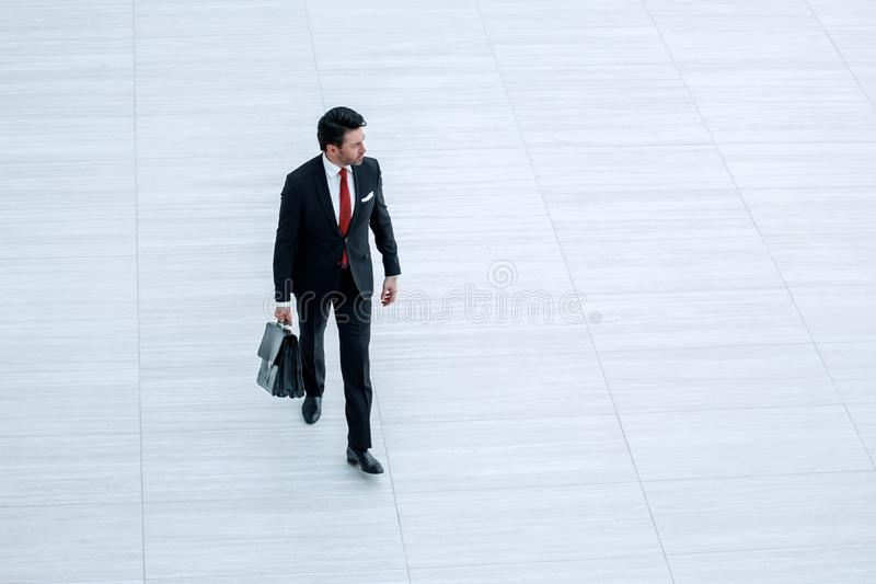 Far away.business man with leather briefcase is coming. Photo with copy space stock photography