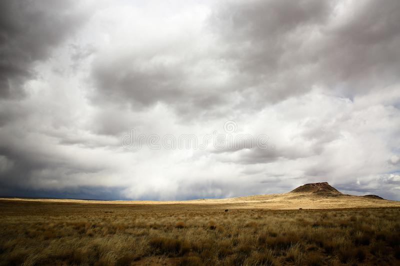 Far Away Clouds in New Mexico. Clouds approaching in the distance in Petroglyphs National Monument, New Mexico stock images
