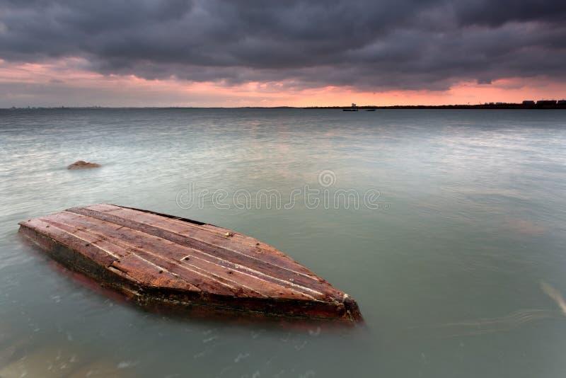 Far away in the sunken ship stock photos