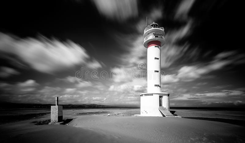 Far del Fangar Lighthouse surreal mood. stock images