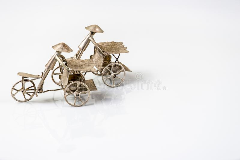Far eastern three wheel bicycle figurines on white back royalty free stock photos