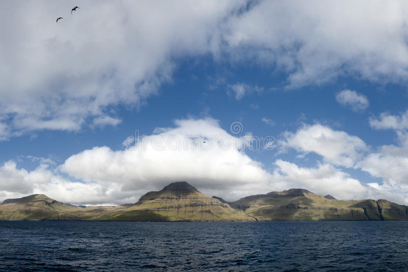 Far Oer Danmark Vestmanna Cliffs Panorama. In cloudy SKY stock photography