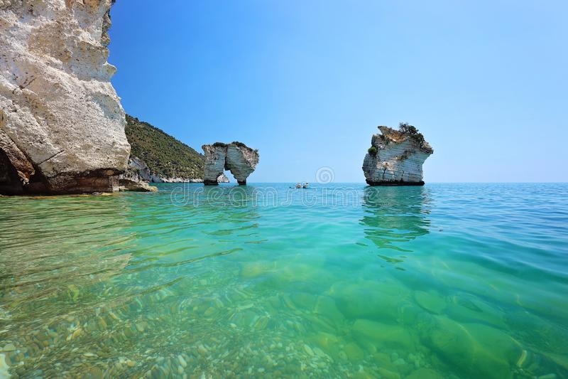 Faraglioni di Puglia Baia delle Zagare - Nature preserve. Stacks, coastal and oceanic rock formation eroded by waves.  stock photography