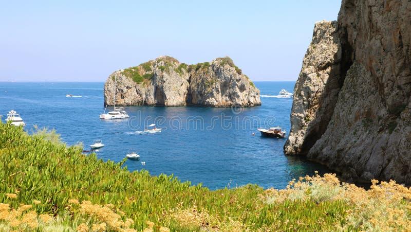 The Faraglioni Rocks on the coast of the Capri Island, Italy stock image