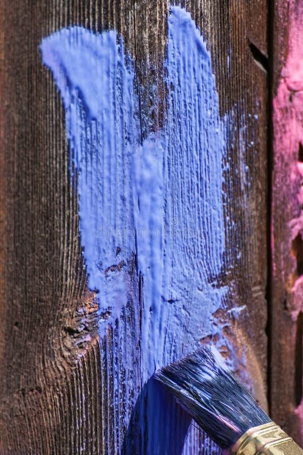 Farba rozmaz na drewnianym tle zdjęcie royalty free