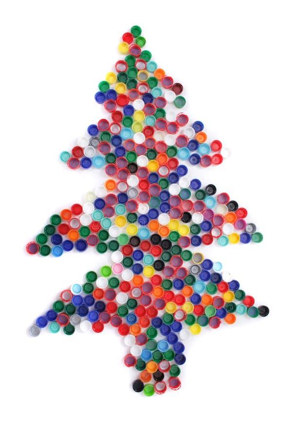 Farbenplastikschutzkappen als Weihnachtsbaum lizenzfreie stockbilder