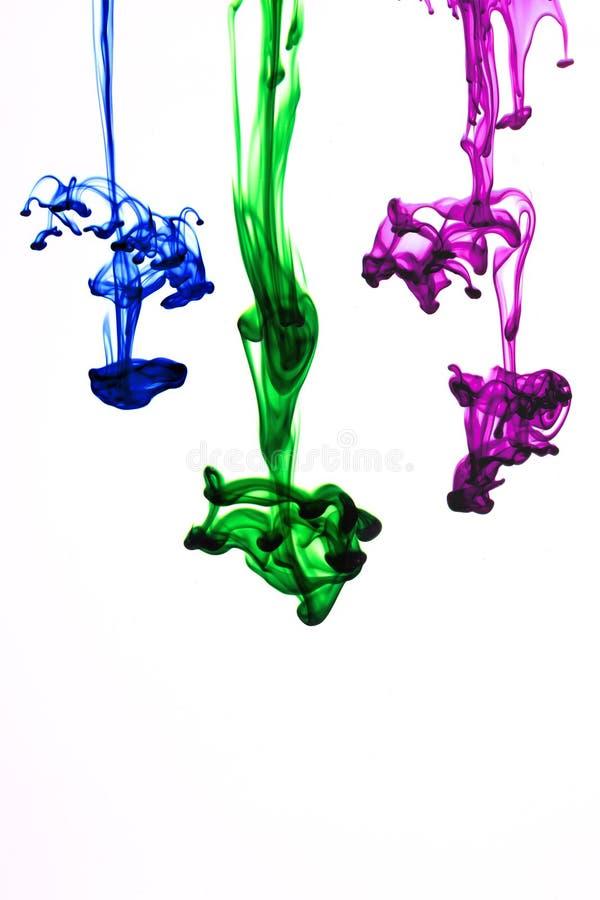 Farbentinte im Wasser lizenzfreie stockfotos