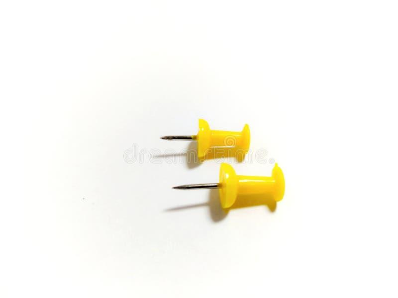 Farbige gelbe Stoßstifte lokalisiert auf weißem Hintergrund lizenzfreie stockfotografie
