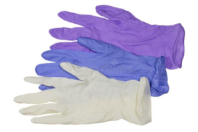 Farbige medizinische Latexhandschuhe auf weißem Hintergrund lizenzfreies stockfoto