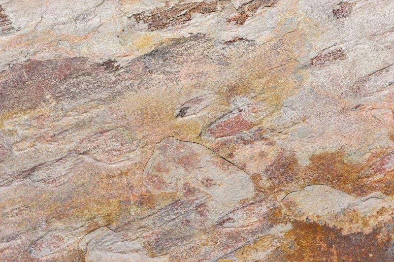 Farbige Mineralsteinschieferhintergrundbeschaffenheit lizenzfreie stockbilder