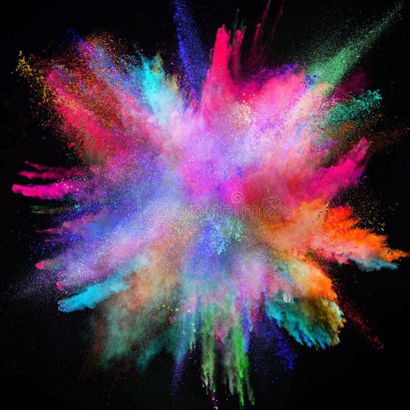 Farbige Pulverexplosion auf schwarzem Hintergrund stockbild
