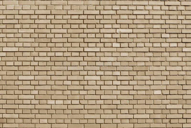 Farbiger Backsteinmauerhintergrund der Mandel Büffelleder lizenzfreie stockfotos
