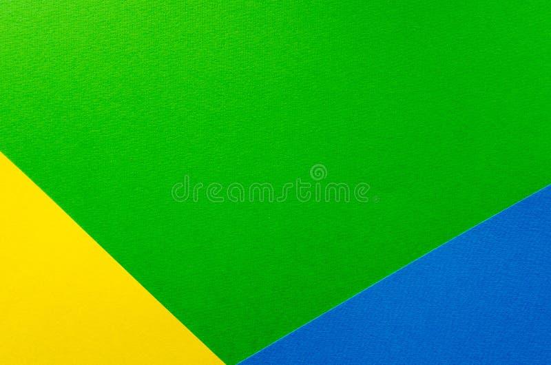 Farbiger geometrischer Beschaffenheitshintergrund des grünen, gelben, blauen Papiers stockbild
