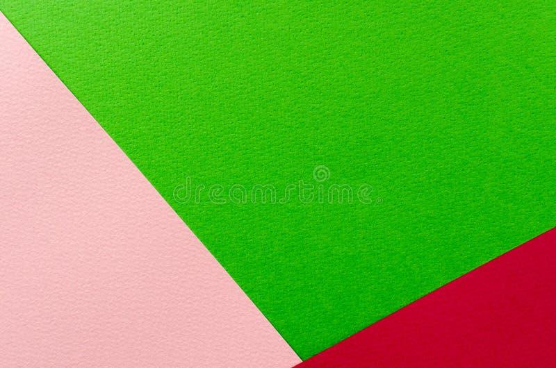 Farbiger geometrischer Beschaffenheitshintergrund des rosa und Grünbuches lizenzfreie stockfotografie