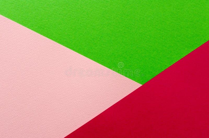 Farbiger geometrischer Beschaffenheitshintergrund des rosa und Grünbuches stockbilder