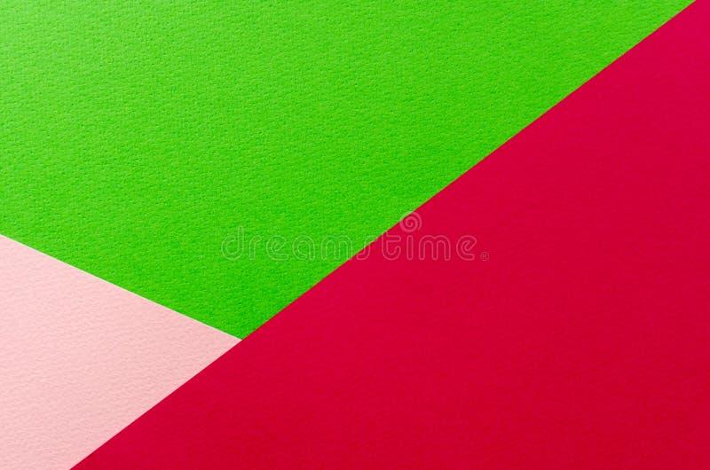 Farbiger geometrischer Beschaffenheitshintergrund des rosa und Grünbuches stockfotografie