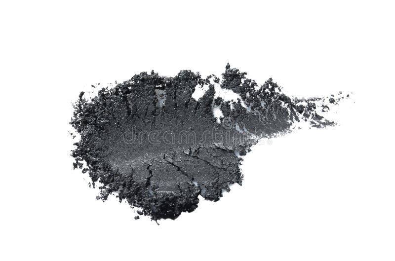 Fard à paupières écrasé sur le fond blanc photographie stock