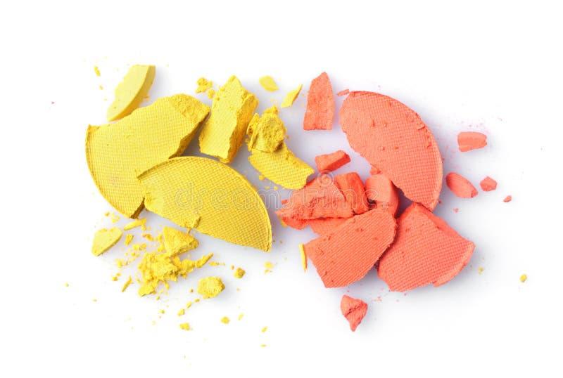 Fard à paupières brisé orange et jaune rond pour le maquillage comme échantillon de produit de cosmétiques photos stock
