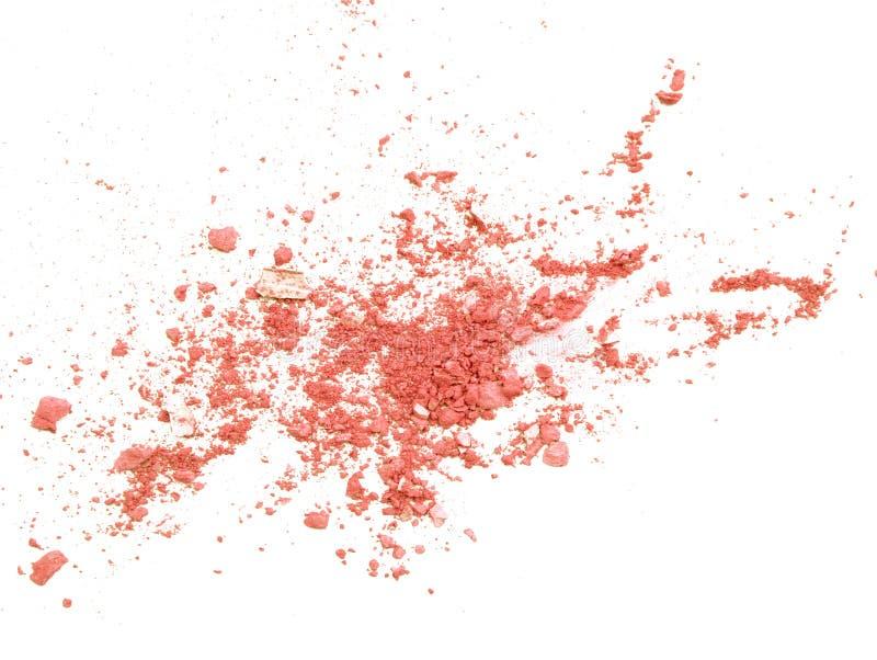 Fard à paupières orange écrasé sur la fin de blanc pour le fond photographie stock