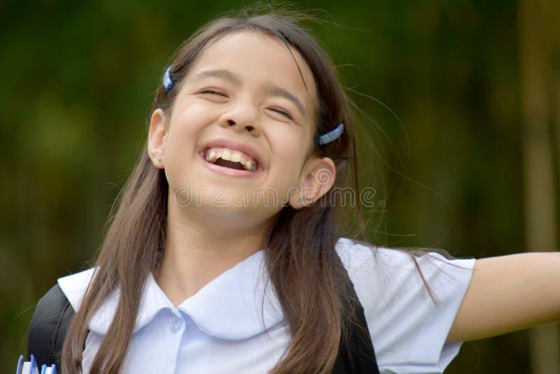 Farda da escola de And Freedom Wearing do estudante fêmea da minoria da preparação foto de stock royalty free