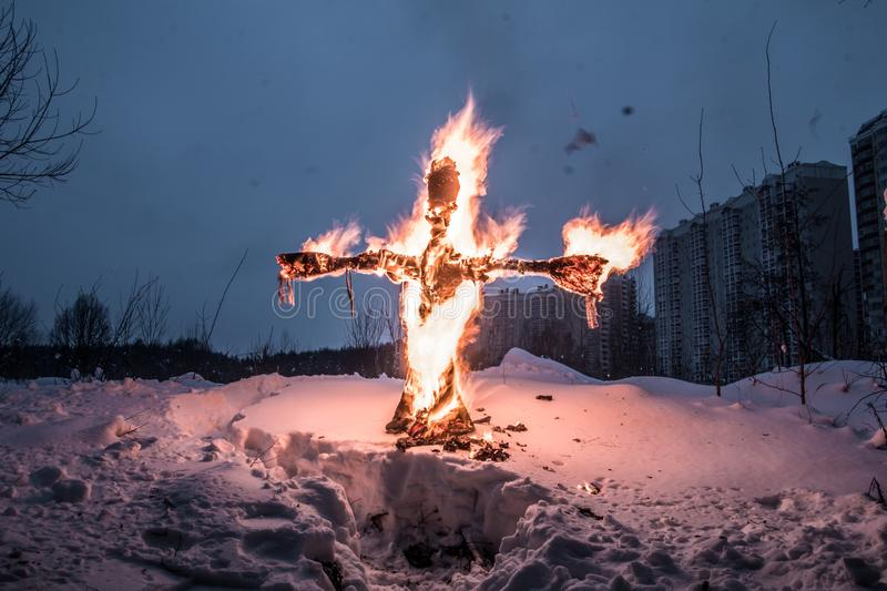 Farewell to winter in Russia. Folk festival. Festivities. Shrovetide. Winter holiday. the burning of effigies. fire. ice stock image