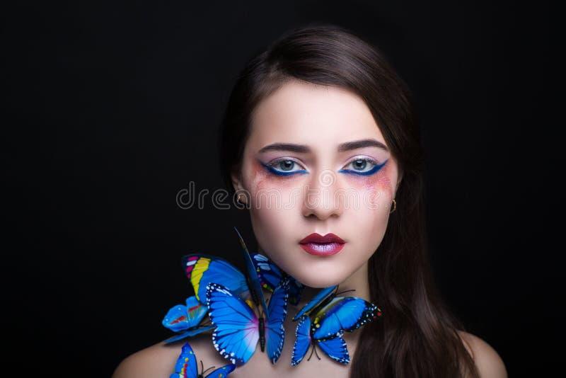 Farfalla del blu della donna immagine stock