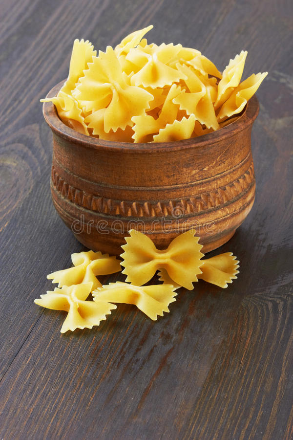 Farfalle italian pasta in wood bowl stock image