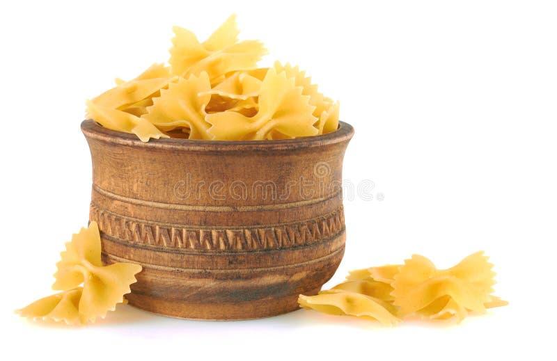 Farfalle italian pasta in wood bowl stock images