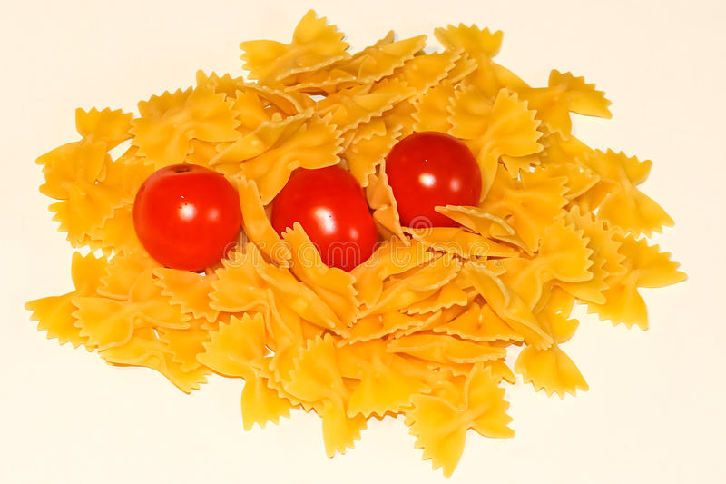 Farfalle pasta and tomato stock photography