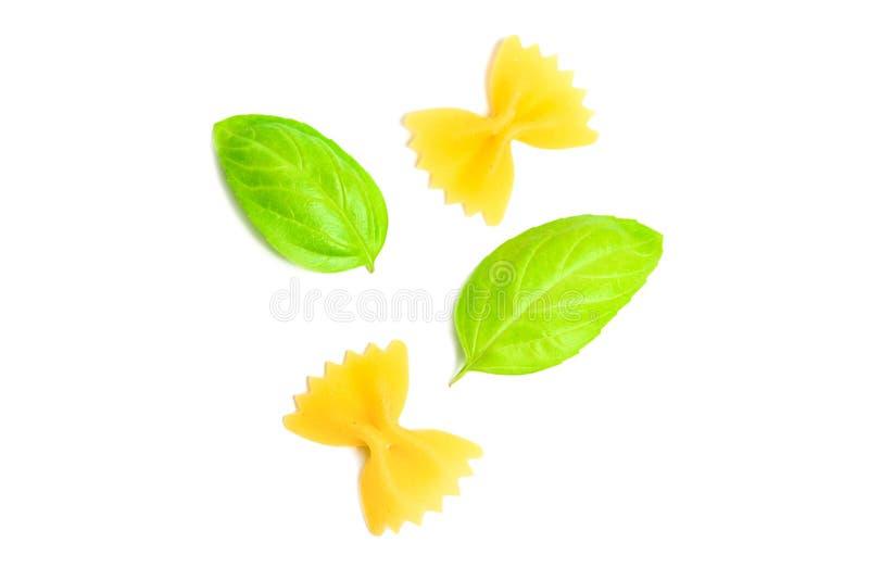 Farfalle or short pasta and oregano leaf isolated on white background royalty free stock image