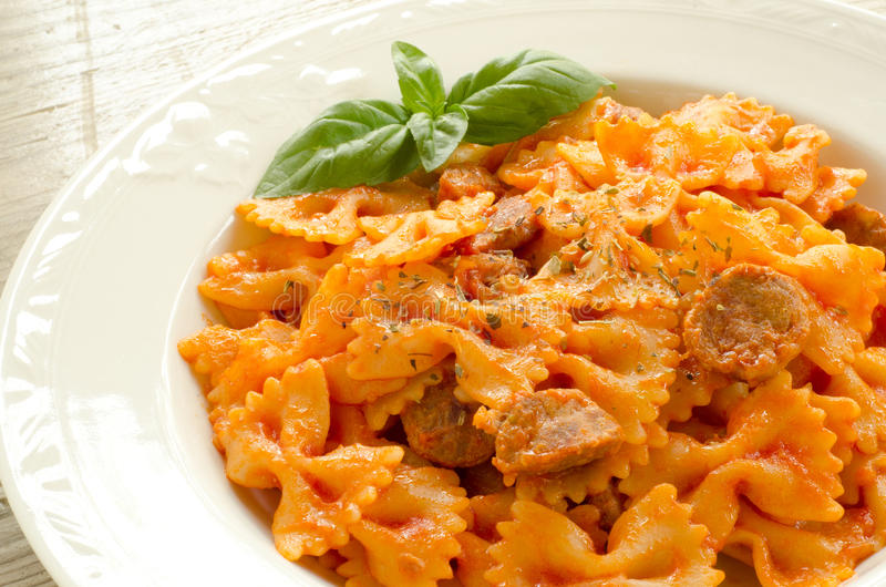 Download Farfalle Topped With Tomato Sauce And Meat Stock Image - Image: 26597825