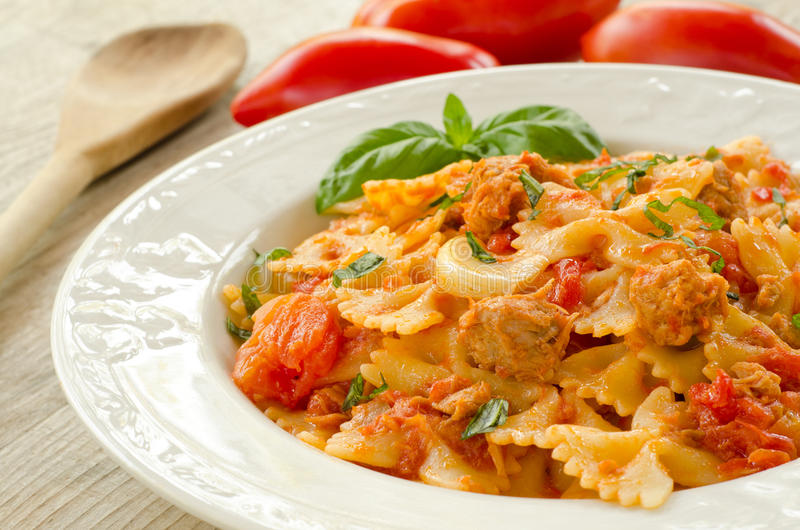 Farfalle topped with tomato sauce and tuna royalty free stock images
