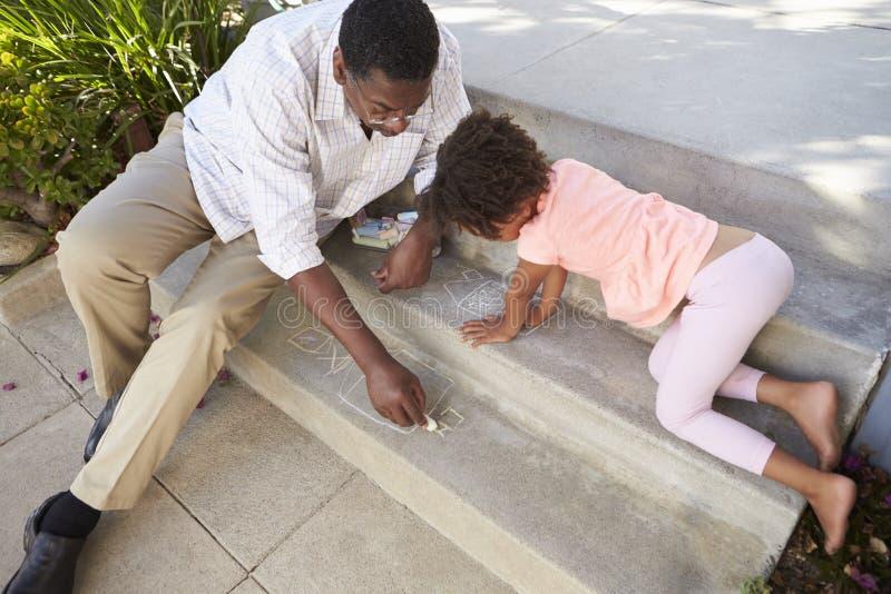 Farfar- och sondotterteckningsbild på moment royaltyfri fotografi