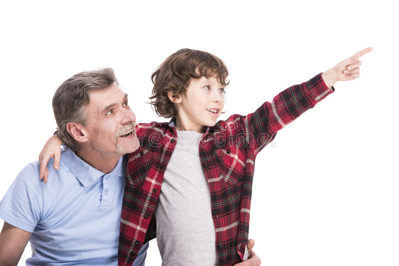 Farfar och sonson arkivbild