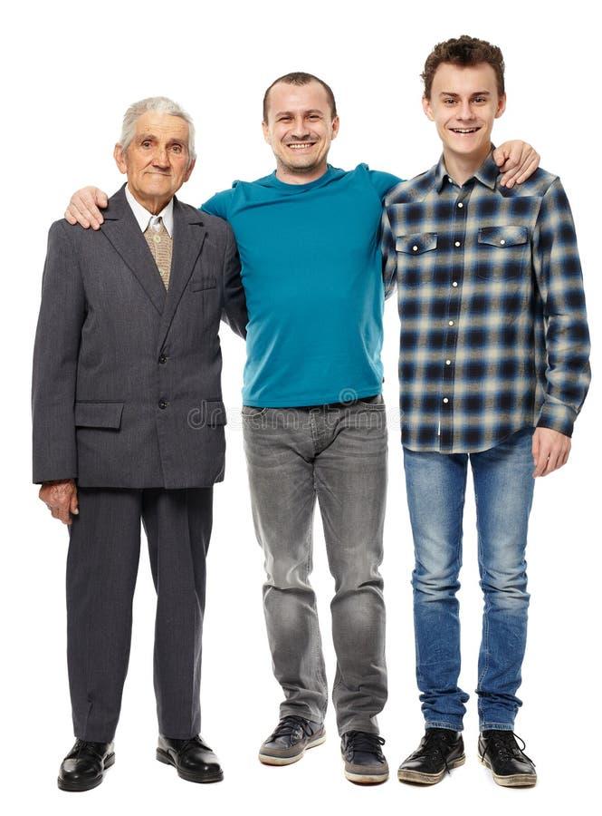 Farfar, son och sonson som isoleras på vit arkivfoton