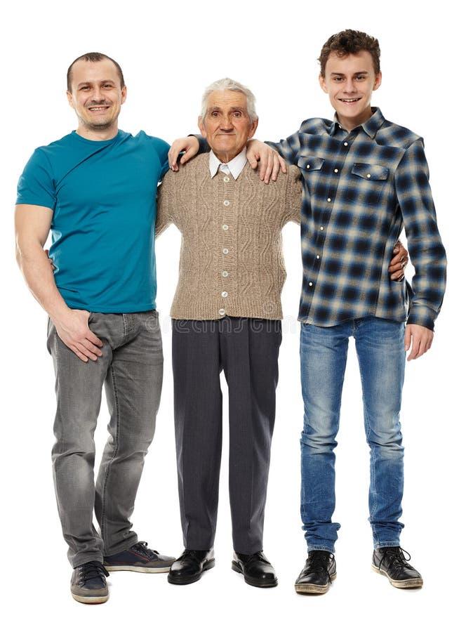 Farfar, son och sonson som isoleras på vit royaltyfria foton